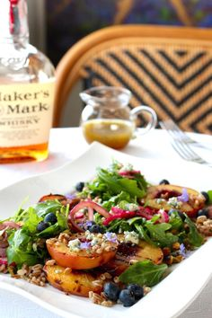 Grilled Peach Salad, Arugula, Farro, Blueberries, Red Onion, Bleu Cheese, Pistachio, Maple Bourbon Rosemary Dressing