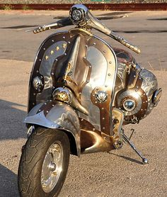 Such a cute steampunk scooter:) Could probably buy a working one with ugly paint,buff the paint off and spray it with copper and silver paint. Fit it with bulky bolt toppers for a funky look.