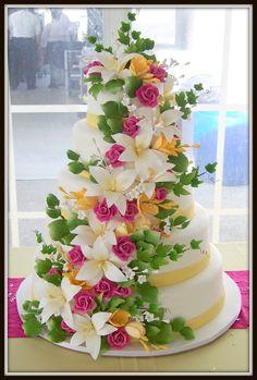 Multi flowers wedding cake by Merci Beaucoup Cakes