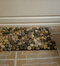 DIY Pebble Mat. (I'm going to use this to make stone trivets for Thanksgiving. I'll put them on lace doilies used as a runner.)