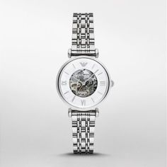 Retro Watch The slim multi-link stainless-steel bracelet of this Emporio Armani ladies' watch keeps the focus on the…