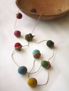 These cute felt acorns make me want to have a fall party.