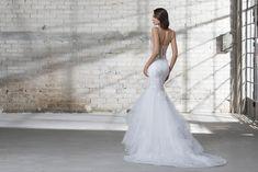 Mermaid Spaghetti Strap Wedding Dress on Kleinfeld Bridal | Mermaid wedding dress with ruffle tulle skirt, spaghetti straps, sweetheart neckline and sheer bodice.