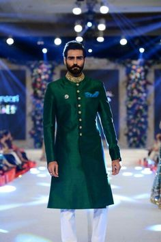 "The second show of the day featured Nomi Ansari who showcasing a bridal collection titled ""Oudh"" at PFDC L'Oréal Paris Bridal Week The collection took Sherwani Groom, Mens Sherwani, Wedding Sherwani, Punjabi Wedding, Indian Groom Wear, Indian Wear, Groom Outfit, Groom Attire, Indian Wedding Outfits"
