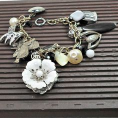 Charm bracelet upcycled embellished by Pat2 size 7 1/4 flowers saddles pearls crystals free shpping by RememberThis3 on Etsy