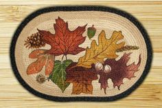 """Capitol Importing 89-315 Autumn Leaves - 20 in. x 30 in. Licensed Art Print Oval by Capitol Importing Company. $24.15. Size: 20 x 30.; Autumn Leaves.; Shape: Oval Braided Rug.; Licensed Art Print.; Artwork by Phyllis Stevens.. Shape: Oval Braided Rug. Autumn Leaves. Licensed Art Print. Artwork by Phyllis Stevens. Size: 20"""" x 30"""".. Save 26% Off!"""