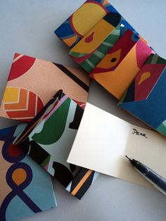 Upcycle all your 2012 wrapping scraps into Mini Greeting Card Envelopes ready for gift giving in 2013!
