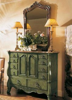 Marble Topped Chest / Antiqued green under a brown framed mirror.  Pretty entry.