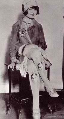 Boyfriend tights    A 1920s fashionista wears tights with portrait of her boyfriend printed on them