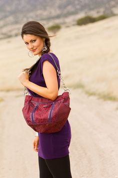 Say hello to Tina. red leopard printed fabric is complemented by a matching set of purple decorative zippers on the front and purple piping accents. Side-pocket storage. This absolutely fearless look is for the woman who faces her day with confidence and loves to show it too!    TINA is only for the woman that wants to make a super hot statement!! Is your statement HOT, or NOT?  https://diva.miche.com