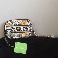 """Vera Bradley Tech Case From designer Vera Bradley, from the """"Go Wild"""" collection. A tech case which I would consider a Wristlet. It has a top zip that goes halfway down one side with strap on opposite side. New with tags, never used. Will bundle with other Vera Bradley. Vera Bradley Bags Clutches & Wristlets"""