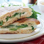 1 tbsp Hellman's light mayonnaise   1 tsp chipotle in adobo sauce (or to taste)   3 oz ciabatta, sliced open   1.75 oz (1 thin) grilled chicken cutlet   1 slice Sargento reduced fat provolone   0.5 oz (about 1/2 cup) baby arugula   Smart Balance cooking spray