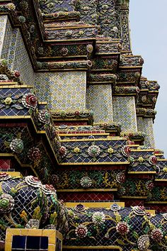 Temple Architecture and decoration. Colorful inlaid porcelain pieces. Bangkok, Thailand.