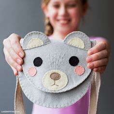 Make this adorable DIY felt bag in the shape of a bear for your daughter, niece, or any other special little one in your life! Design by Lia Griffith