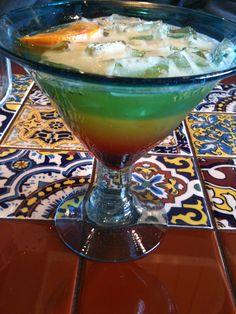 Chili's Tropical Sunrise Margarita. Sauza Hornitos Reposado Tequila (100% Blue Agave), DeKuyper Melon liqueur, pineapple juice and a splash of grenadine. My favorite.