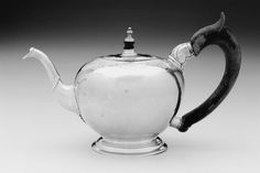 Silver Teapot - about 1730 - Paul Revere, Sr. (American (born in France, baptized Apollos Rivoire), 1702–1754) -  Made in Boston, Masachussetts -  Dimensions: 14.8 x 24 cm (5 13/16 x 9 7/16 in.)