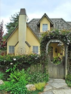 sweet yellow cottage... Ok,ok,ok..someone buy me this house and I'll take your advice and move!  Haha! I don't even care where it is!