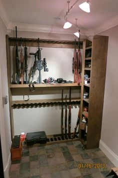 Double Level Vertical Gun Rack with Storage Shelves for a customer gun room.  www.gun-racks.com