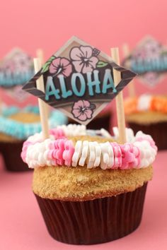 Pineapple Cupcakes with Mango Frosting (graham cracker crumbs for the sand) and cute candy leis!
