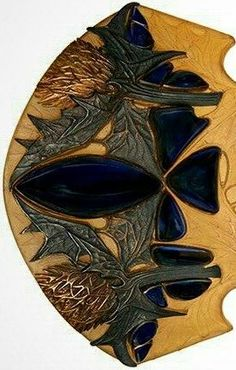 "Rene Lalique (1860-1945), Sea Holly hair comb, France, circa 1900, horn, silver, gold, glass, signed, 3 3/4""w x 5 1/8""l. Provenance: Parke-Bernet Galleries Inc., New York, NY, 24 April 1971, Lot 19, Literature: Sigrid Barten, Rene Lalique Schmuck und Objets d'art 1890-1910, Munchen, Prestel-Verlag, 1977, page 188, no. 82, 1A, We are grateful to Janet Zapata for her assistance with the cataloguing of this lot. Property from: The Warshawsky Collection, Chicago, Illinois"