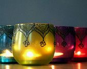 3 Small Morrocan Inspired Candle Lanterns, Amethyst Tinted  Glass With Black Accents. $34.00, via Etsy.
