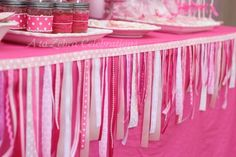 Love this ribbon garland table decoration idea. Except add some reds in there too.