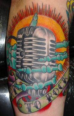 Vintage microphone / skeleton hand / born to rock tattoo by Chris Stuart www.chrisstuarttattooing.com www.facebook.com/chrisstuarttattooing Instagram: @chrisxempire Chrisstuarttattooing@gmail.com Ace Tattoos, Charlotte,NC