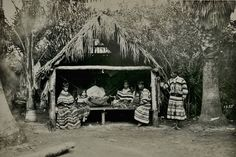 Seminole family and their home known as a chickee, in Florida - 1921