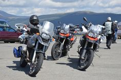 BMW motorcycles on the side of the road. You'll hear the engine roaring in a minute www.motorcycle-tours.travel