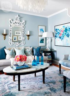 7 mini living room makeovers. Love the blues tones with the fresh whites and pop of coral.
