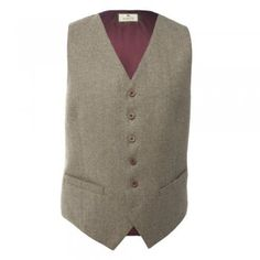 A classic two pocket waistcoat. The fabric is a moss green herringbone tweed with a green viscose back. A regular fitting garment. Features include two jetted pockets, half belt adjuster at the back and size buttons.