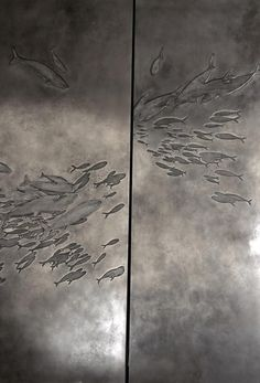 Impressed fish onto metal makes for a shine effect to create the depth in the piece. It reminds me of deep sea where all you see is darkness and black.