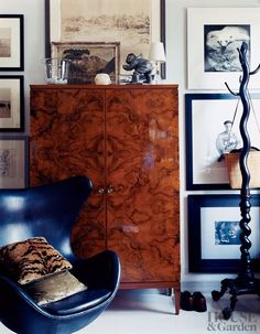 The den of Thomas O'Brien's New York home features an Arne Jacobsen Egg chair and a Gio Ponti wardrobe topped with an antique Inuit stone figure.