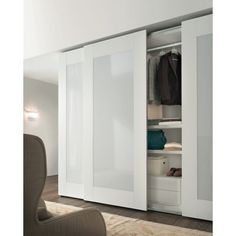 Bedroom. Nice White Wardrobe Design Sliding Door Wardrobe Frosted Glass Door Modern Style Together With Storage Shelves Fabric Covered Wingback Chair Beige Fur Rug Dark Wooden Floor. Classy Bedroom Wardrobe Styles