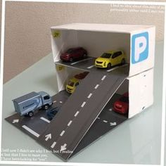 Image only: Design for toy car garage. Cardboard Box Crafts, Cardboard Toys, Indoor Activities For Toddlers, Toddler Learning Activities, Projects For Kids, Diy For Kids, Crafts For Kids, Diy Pour Enfants, Toy Garage