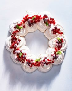 Enchant guests (but keep things easy in the kitchen) with this ethereal wreath of pavlova puffs. Each segment of tender, silky goodness cradles a dollop of tangy cream and jewel-like fruit. Christmas Cooking, Christmas Desserts, Christmas Treats, Christmas Goodies, Just Desserts, Dessert Recipes, Trifle Desserts, Chef Recipes, Bolo Diy