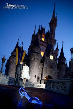 He found her glass slipper and now they're off to the Cinderella Castle! #wedding #Disney #blue. Photo: Ty, Disney Fine Art Photography