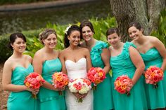 Turquoise and Coral Beach wedding! Each bridesmaid got to pick out their own style of dress!