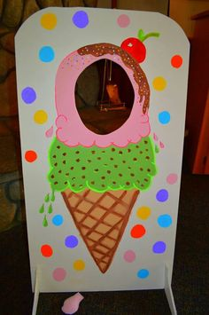 """Photo prop from our ice cream social. It doubled as a """"bean"""" toss too! The bean bags I made from (brain freeze) ice cream fabric and fleece. The bean bags were used for our hopscotch game too. Friends took them home to use later for handwarmers!;)"""