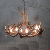 """Our """"Headed High"""" elk antler chandelier with bronze elk figurines.  Proudly made in America and no animals ever harmed. http://www.realantlerchandeliers.com/Peak-Headed-High-Bronze-Elk-Antler-Chandelier-8-Light.html"""