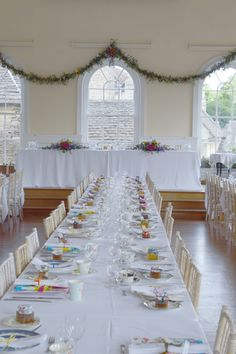 Garlands and top table mixed summer flowers at Corsham Town Hall