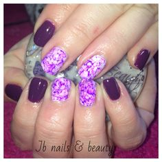 Purple gel polish on natural nails with sharpie art