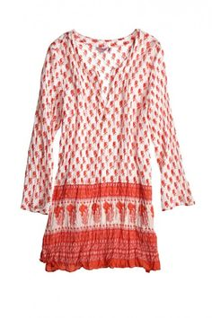 Lulu Purify Block Print Tunic:   Cherry red paisley shaped buds  bloom over a pure white background.