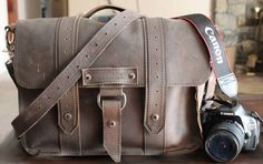I love this camera bag. leather. buckles, straps, rugged.