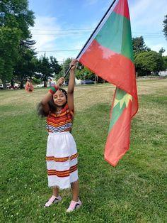 An Oromo Girl holding Oromia flag.  She is Oromia's hope. #BrightFuture.  Oromo Girl in Seattle Washington. Oromo People, Horn Of Africa, Bright Future, African Culture, Seattle Washington, Hold On, Ethnic, Flag, History