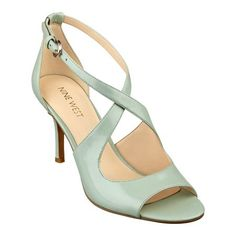 """Graduated straps cross atop an ever-so posh pump set on a demure covered heel. Padded footbed for all-day comfort. Leather upper. Man-made lining and sole. Imported. 3"""" heel."""