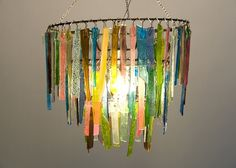 ...of glass. I love this chandelier. If you think it's pretty, you should check out all of the other wonderful things her shop has to offer. I LOVE IT!