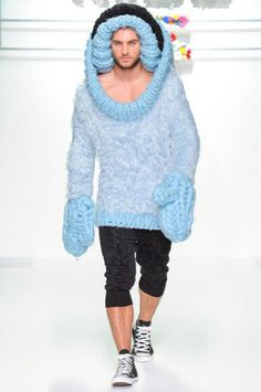 Yes, this poor male model had to wear this awful outfit down the runway!!