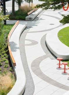 Stamped colored concrete for a curvilinear designed public park. The very edges of the paving use a semi permeable paving.