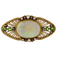 Louis C. Tiffany for Tiffany & Co. Diamond, Demantoid Garnet, Opal and Gold Filigree Brooch | From a unique collection of vintage brooches at http://www.1stdibs.com/jewelry/brooches/brooches/